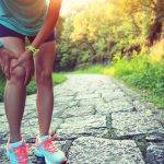 Woman runner hold her sports injured knee. Athlete, female.