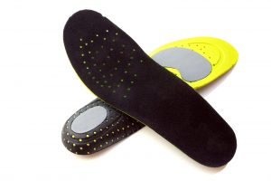 Effectiveness of foot orthoses and shock-absorbing insoles for the prevention of injury: a systematic review