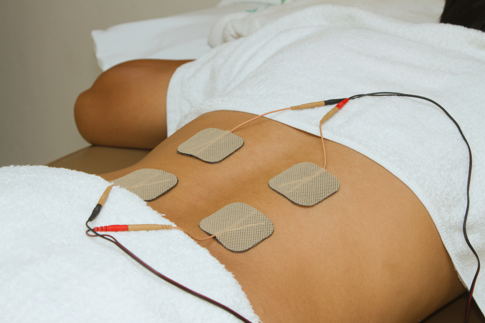 Patient Applying Electrical Stimulation Therapy ( Tens ) On His