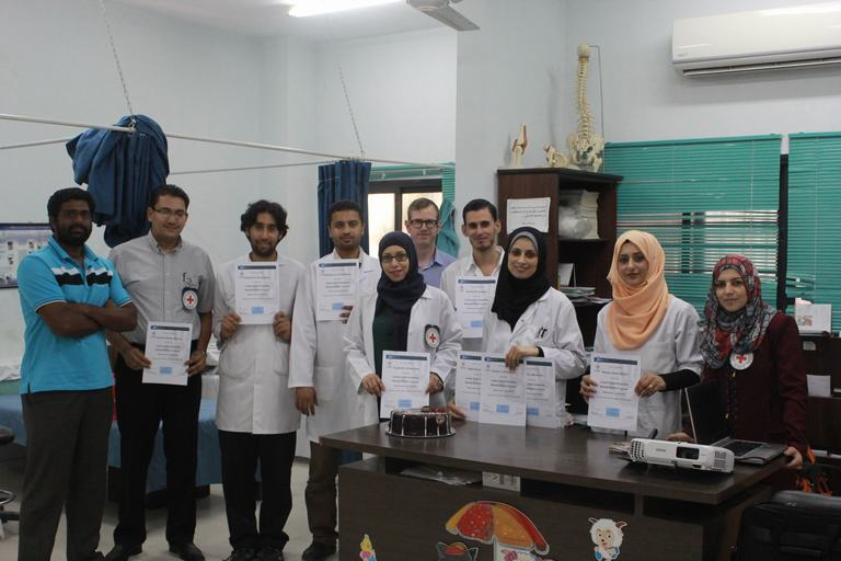Physiopedia students in Gaza receiving their certificates from the amputation course